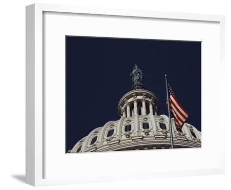 An American Flag and the Statue of Freedom Atop the Capitol Dome-Medford Taylor-Framed Art Print
