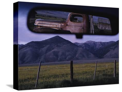 An Old Truck and Barn are Reflected in a Rear-View Mirror-Joel Sartore-Stretched Canvas Print