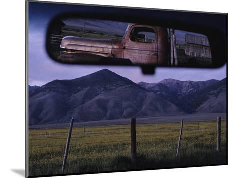 An Old Truck and Barn are Reflected in a Rear-View Mirror-Joel Sartore-Mounted Photographic Print