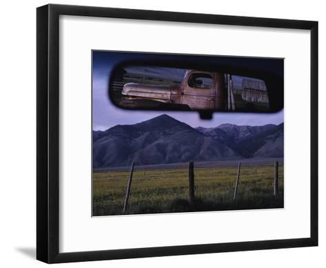 An Old Truck and Barn are Reflected in a Rear-View Mirror-Joel Sartore-Framed Art Print