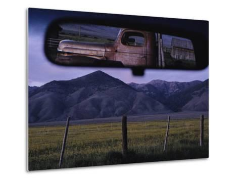 An Old Truck and Barn are Reflected in a Rear-View Mirror-Joel Sartore-Metal Print