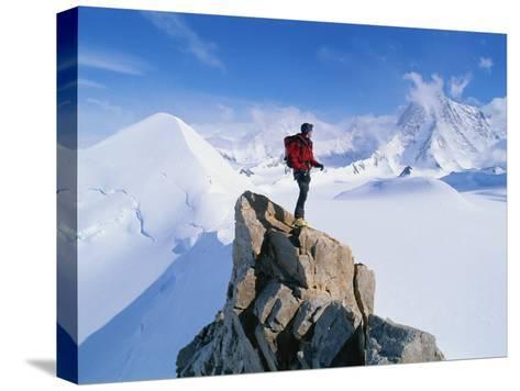 A Mountain Climber Summits Mount Bearskin-Gordon Wiltsie-Stretched Canvas Print
