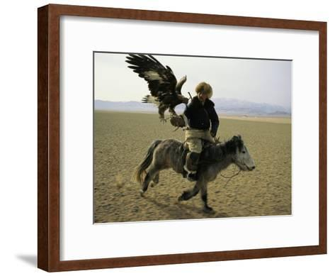 A Mongolian Eagle Hunter in Kazahkstan-Ed George-Framed Art Print