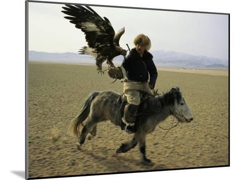 A Mongolian Eagle Hunter in Kazahkstan-Ed George-Mounted Photographic Print