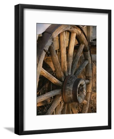 Wagon Wheel on Covered Wagon at Bar 10 Ranch Near Grand Canyon-Todd Gipstein-Framed Art Print