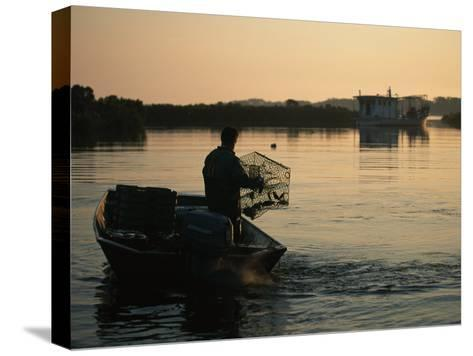 Fisherman in Boat Emptying His Crab Trap-Medford Taylor-Stretched Canvas Print