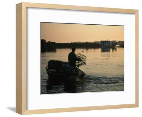 Fisherman in Boat Emptying His Crab Trap-Medford Taylor-Framed Art Print