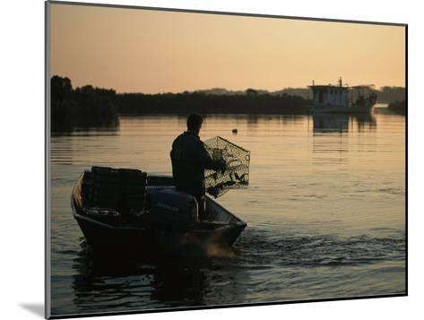 Fisherman in Boat Emptying His Crab Trap-Medford Taylor-Mounted Photographic Print