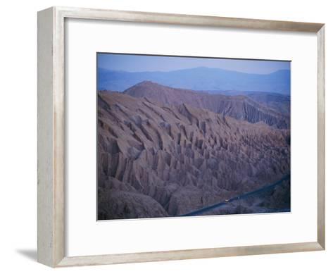 The Desert Dwarfs the One Road from Calama to San Pedro De Atacama-Joel Sartore-Framed Art Print