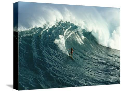A Surfer Rides a Powerful Wave off the North Shore of Maui Island-Patrick McFeeley-Stretched Canvas Print