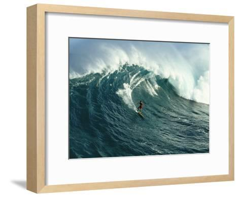 A Surfer Rides a Powerful Wave off the North Shore of Maui Island-Patrick McFeeley-Framed Art Print