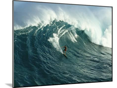 A Surfer Rides a Powerful Wave off the North Shore of Maui Island-Patrick McFeeley-Mounted Photographic Print