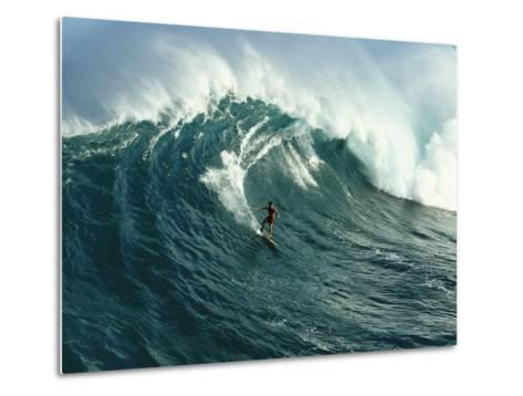 A Surfer Rides a Powerful Wave off the North Shore of Maui Island-Patrick McFeeley-Metal Print