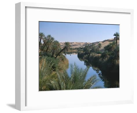 The Photographer Discovers an Oasis in the Middle of the Sahara Desert-Peter Carsten-Framed Art Print