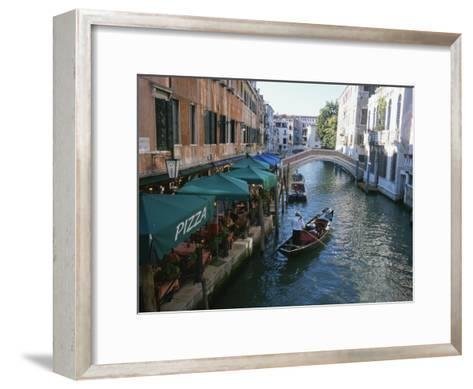 A Gondolier Passes a Restaurant on a Canal in Venice, Italy-Taylor S^ Kennedy-Framed Art Print