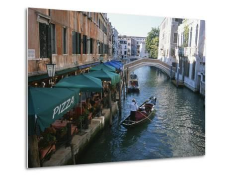 A Gondolier Passes a Restaurant on a Canal in Venice, Italy-Taylor S^ Kennedy-Metal Print