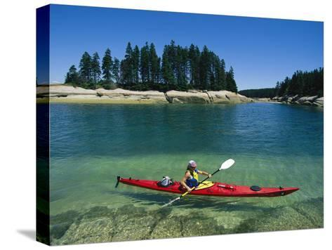 Woman Kayaks Through the Clear Water of Penobscot Bay, Maine-Skip Brown-Stretched Canvas Print