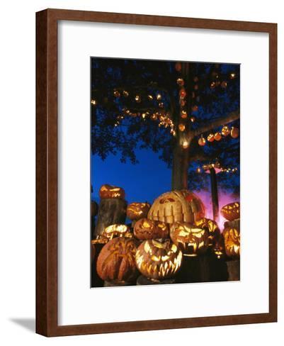 Grinning Lit Jack-O-Lanterns Surrounding and Filling a Tree-Richard Nowitz-Framed Art Print