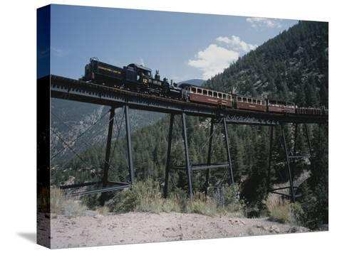 A Steam Engine Comes into the Silver Plume Station in Colorado-Taylor S^ Kennedy-Stretched Canvas Print