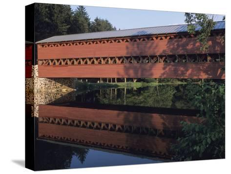 The Sachs Mill Bridge is Reflected in the Marsh River-Raymond Gehman-Stretched Canvas Print
