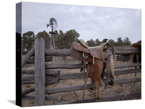 A Saddle is Left Behind by Some Ranchers in the Nebraska Sandhills-Joel Sartore-Stretched Canvas Print