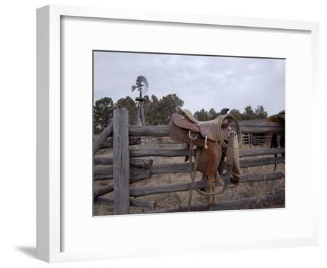 A Saddle is Left Behind by Some Ranchers in the Nebraska Sandhills-Joel Sartore-Framed Art Print