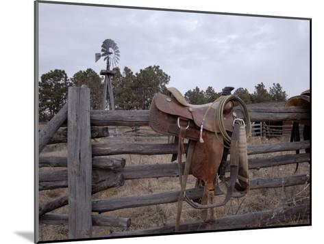 A Saddle is Left Behind by Some Ranchers in the Nebraska Sandhills-Joel Sartore-Mounted Photographic Print