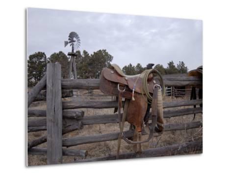 A Saddle is Left Behind by Some Ranchers in the Nebraska Sandhills-Joel Sartore-Metal Print