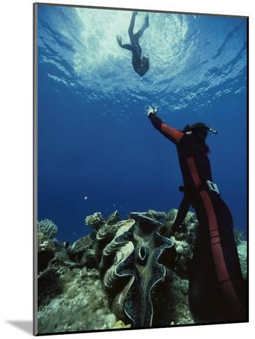 A Diver on the Sea Floor Gestures to Another Diver Who is Descending-Bill Curtsinger-Mounted Photographic Print