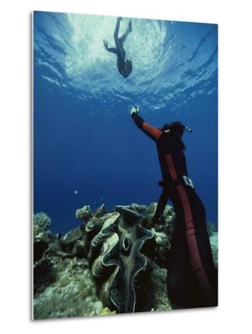 A Diver on the Sea Floor Gestures to Another Diver Who is Descending-Bill Curtsinger-Metal Print