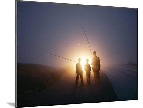 Three Men Walking Toward Their Car after a Day Spent Trout Fishing-Sam Abell-Mounted Photographic Print