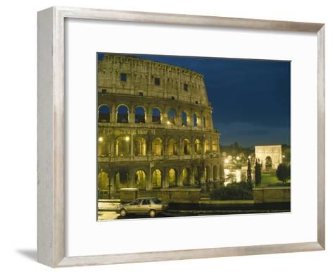 Romes Colosseum Illuminated at Night-Richard Nowitz-Framed Art Print