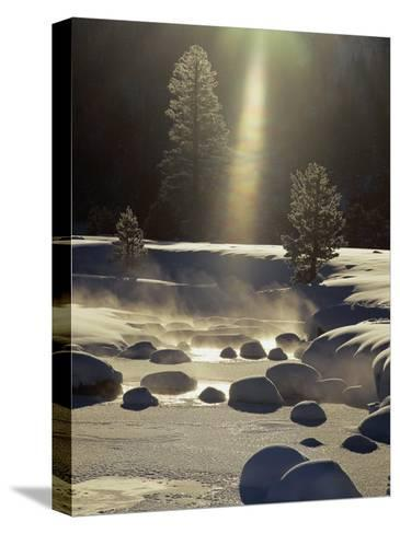 Steam Rises off the Snow-Covered River-Phil Schermeister-Stretched Canvas Print