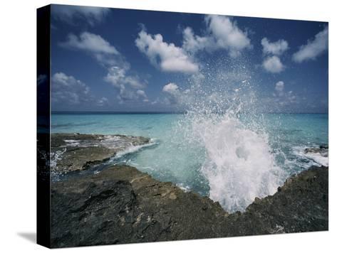 A Spray of Water Upon a Rocky Coast-Kenneth Garrett-Stretched Canvas Print