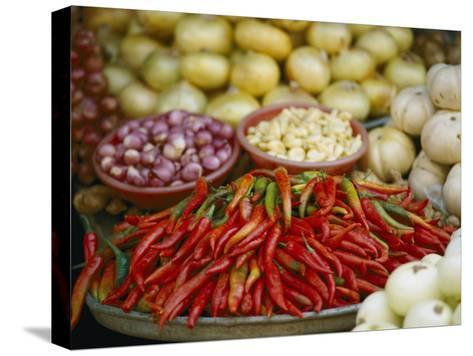 Close View of Chili Peppers and Other Vegetables at a Food Market-Steve Raymer-Stretched Canvas Print