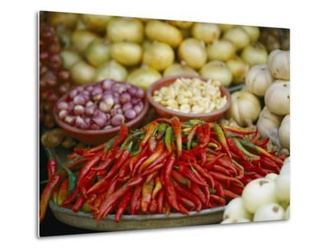 Close View of Chili Peppers and Other Vegetables at a Food Market-Steve Raymer-Metal Print
