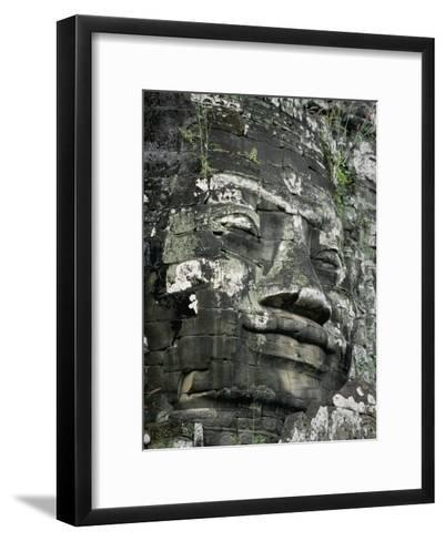 A Serene Likeness of Buddha Sculpted of Stone Peers from a Temple Wall-Paul Chesley-Framed Art Print