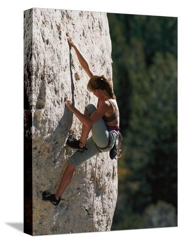 A Female Climber Searches for a Hold-Bobby Model-Stretched Canvas Print