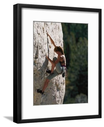 A Female Climber Searches for a Hold-Bobby Model-Framed Art Print