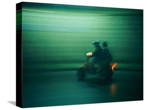 Panned Shot of Two People on a Small Scooter-Michael S^ Lewis-Stretched Canvas Print