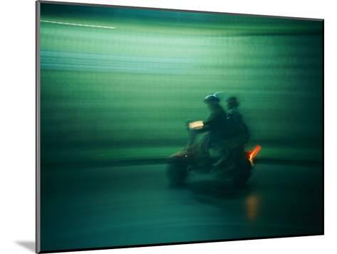 Panned Shot of Two People on a Small Scooter-Michael S^ Lewis-Mounted Photographic Print