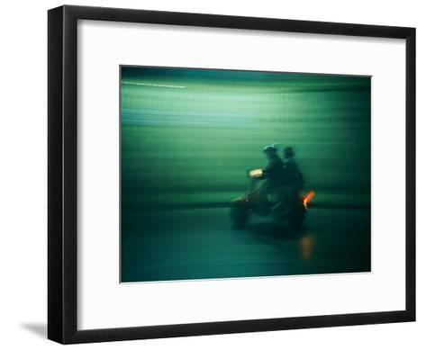 Panned Shot of Two People on a Small Scooter-Michael S^ Lewis-Framed Art Print