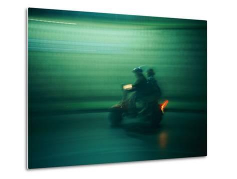 Panned Shot of Two People on a Small Scooter-Michael S^ Lewis-Metal Print