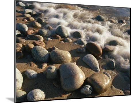 Water Washes up on Smooth Stones Lining a Beach-Michael S^ Lewis-Mounted Photographic Print