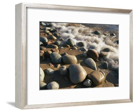 Water Washes up on Smooth Stones Lining a Beach-Michael S^ Lewis-Framed Art Print