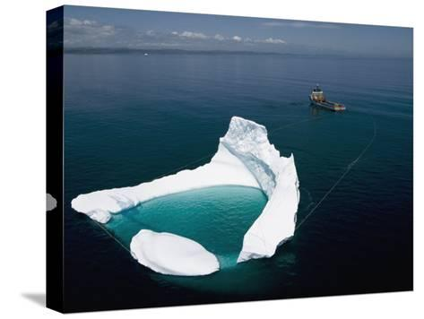 Towing an Iceberg Away from an Oil Platform-Randy Olson-Stretched Canvas Print