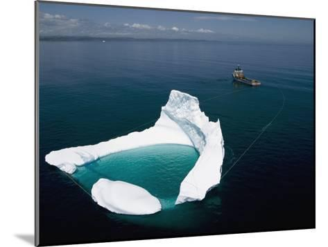 Towing an Iceberg Away from an Oil Platform-Randy Olson-Mounted Photographic Print