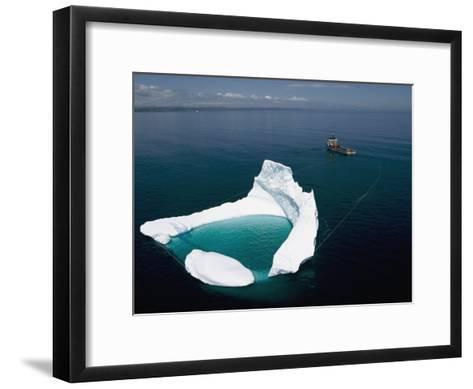 Towing an Iceberg Away from an Oil Platform-Randy Olson-Framed Art Print