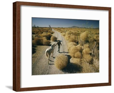 A Man Leads a Horse Down a Dirt Road-Walter Meayers Edwards-Framed Art Print