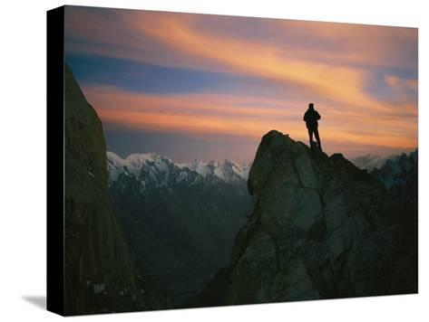 A Silhouetted Climber Watches the Sun Set over the Karakoram Mountains-Bobby Model-Stretched Canvas Print